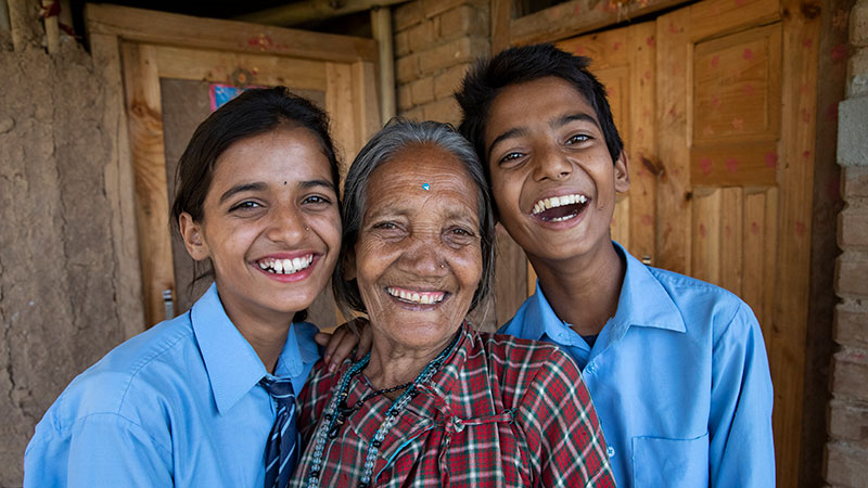 Ganga Devi (center) with her twin grandchildren Aayush (left) and Sadhan in her home in Kavre rebuilt after 2015 Nepal earthquake