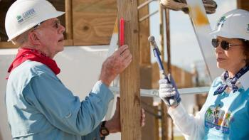Jimmy and Rosalynn Carter building with Habitat