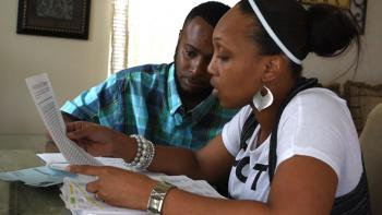 Habitat family reviewing their personal finances