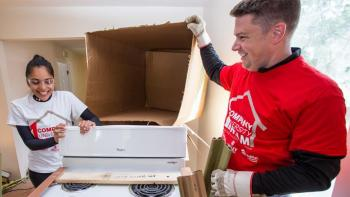 Volunteers open a donated Whirlpool range