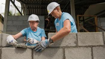Volunteers laying bricks in Thailand