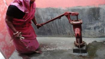 A woman using a water pump. Why is clean water important?
