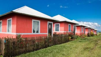 Row of pink houses, Philippines, MicroBuild Fund, Habitat for Humanity