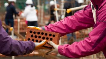 Volunteers laying bricks, pay it foward, Habitat for Humanity