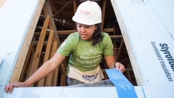Stories of service, Valerie Nguyen installs a window during the annual Habitat AmeriCorps Build-a-Thon