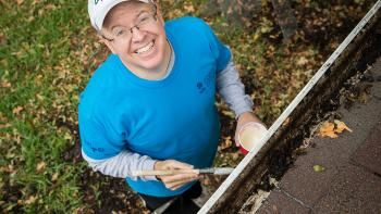 Neighborhood revitalization volunteer paints