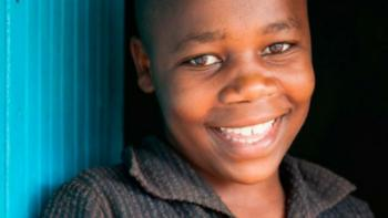 a boy from Kenya smiling