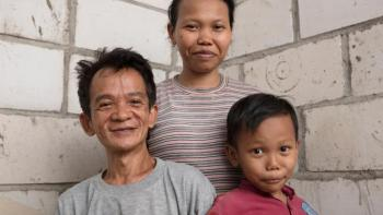 Abdul with his wife Warkatul and son Arman in their home in Tegal Sari, Indonesia.