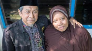 Ilyas, principal of SD Mustajabah school in Tegal Sari, and his wife Fatima