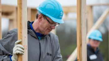 Habitat CEO Jonathan Reckford helps raise walls in Nashville, Tennessee