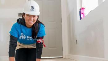 Habitat volunteers help future homeowners build houses.