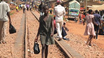 uganda-slum-girl-walking-railiways