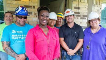 Volunteers in Texas work with a Habitat homeowner.
