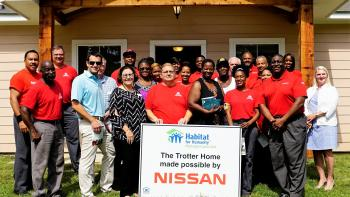 group of Nissan employees at house dedication.