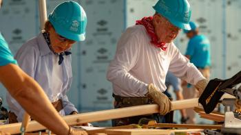 President Carter works on the build site.