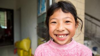 Xinyi, 8, lives in a Habitat house in southern China that was built by her grandfather more than a decade ago. Photo: Habitat for Humanity/Jason Asteros.