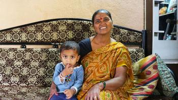 Lata, seen with her neighbor's son, built her home during 2006 Carter Work Project in Lonavala, India
