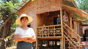 Myint Myint Sein in front of her Habitat bamboo home in Myanmar.