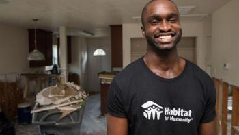 Harvey cleanup house with smiling volunteer