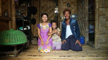 (From left) Bok Bok with her daughter Shwe Yati and husband Pyae Phyo in their Habitat home in Myanmar. They live under one roof with Bok Bok's mother and other family members.