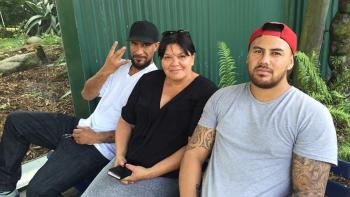 Habitat homeowner Mihi, with her sons, outside her home in New Zealand.