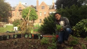 Steven Yang smiling in his garden.