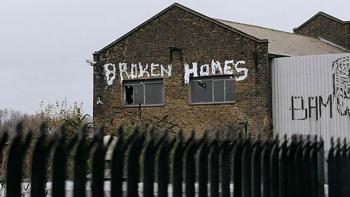 "Photo: ""broken homes"" written on a broken house"