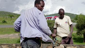 Photo: two man building a wall in Kenya