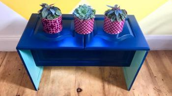 Plant stand with three plants.