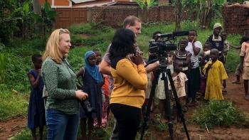 people making film on housing in Uganda