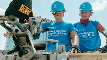 Photo: two volunteers use Stanley Black & Decker tool