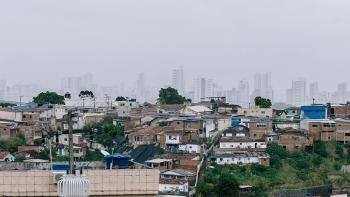 Photo: city of Alta de Santa Terezinha in Brazil. Contrast of slum areas and rich part of the city.