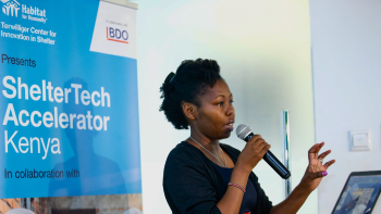 A participant of ShelterTech Accelerator Kenya speaks into a microphone.