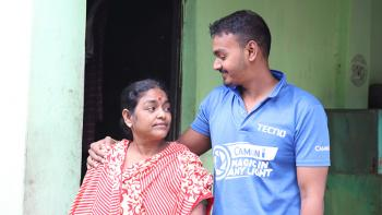 Lalita and her son Biddut in front of their home in Bangladesh.
