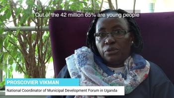 Photo: Proscovier Vikman talking about Uganda