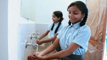 Students in India washing hands