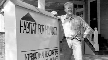 Former U.S. President Jimmy Carter with Habitat sign.