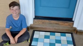 Theresa's son Jack sits next to his finished project.