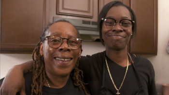Chef Ro and her mom in the Habitat house she grew up in.