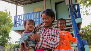 Han and her children in front of their home completed during Cambodia Big Build 2019.