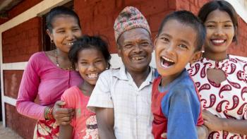 The Danuwar family of five, pictured smiling here, partnered with Habitat for Humanity Nepal to rebuild the home they lost during the 2015 Nepal earthquake.