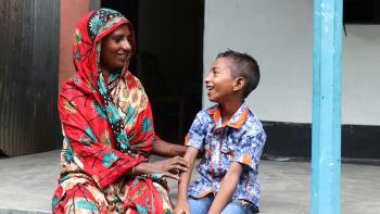 Samala and her son Aminul at the porch of their house in Jamalpur district, Bangladesh