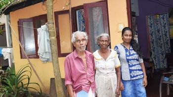 Shashika (far right) with her grandparents Arthur and Silard in front of their home in Moratuwa, Sri Lanka