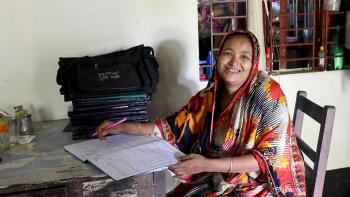 Habitat homeowner Sakina catching up on work at home in Bangladesh
