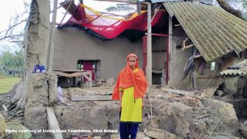 A woman whose home is destroyed by Cyclone Amphan in West Bengal