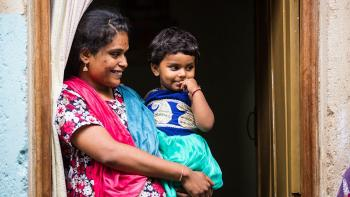 Indian woman with child. Photo from Habitat India's Facebook page.
