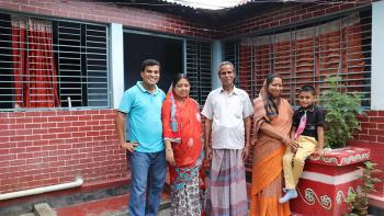 Ashish and his family outside their home in Mymensingh, Bangladesh.