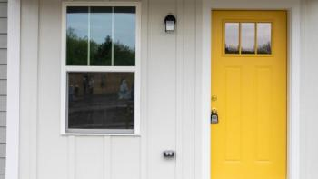 A house with a bright yellow door.