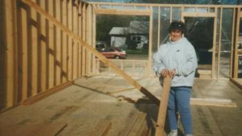 Cathy on the build site of her home in 1995.