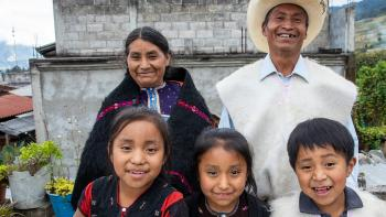 Camilo with his wife and three kids in front of their cement block Habitat home in picturesque Chiapas, Mexico.